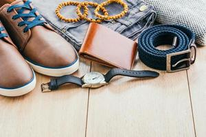 Clothes and fashion accessories on wooden floor photo