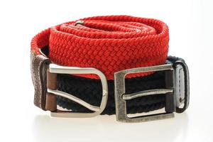 Belts with buckle on white background photo