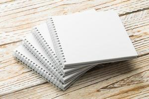 Blank notebook mock up on wooden background