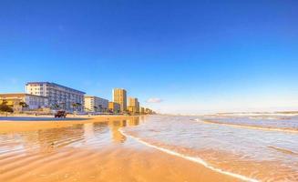 Shoreline, beach, and row of resorts at Daytona Beach, Florida photo