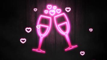 animação closeup pequenos corações românticos rosa e taças de champanhe no fundo do dia dos namorados video