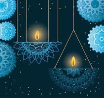 Happy diwali hanging candles with blue mandalas vector design