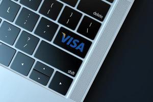 logotipo de visa en el teclado de la computadora portátil