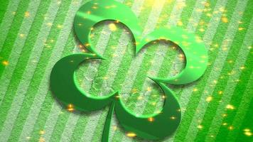 Animation gros plan motion grand trèfle vert et paillettes d'or sur fond brillant de jour de saint patrick