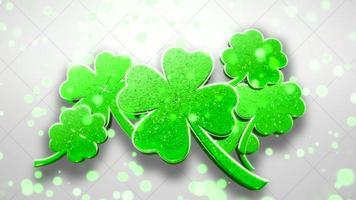 Animationsbewegung kleine grüne Kleeblätter mit Glitzern auf dem glänzenden Hintergrund des Heiligen Patrick-Tages. video