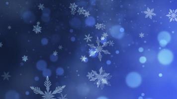 abstrakt blå bokeh och snöflinga faller. gott nytt år och glänsande jul blank bakgrund