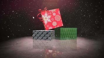 Animated closeup Christmas gift boxes on snow and shine background