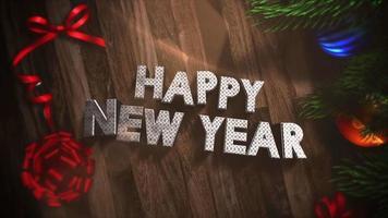 Primer animado texto feliz año nuevo, cajas de regalo y ramas de árboles verdes con bolas en madera video