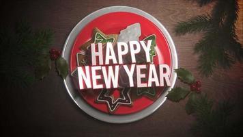 Texte de bonne année gros plan animé, bonbons et tarte de Noël sur fond de bois video