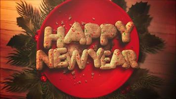 Primer plano animado texto feliz año nuevo, dulces y pastel de Navidad sobre fondo de madera