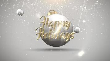 Texte de joyeuses fêtes de gros plan animé, boules de mouvement et flocons de neige sur fond blanc video
