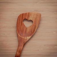 Wooden utensil with heart cutout