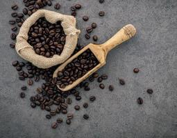 Dark roasted coffee beans in a sack photo