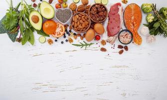 Fresh foods and copy space on a shabby white background photo