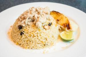 Fried rice with pineapple on white plate photo