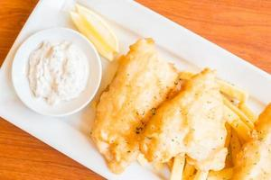 Fish and chip on a white plate