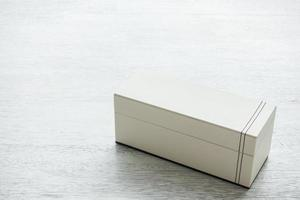 White leather box on wooden background