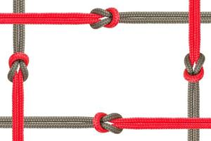 Different ropes tied together isolated on a white background