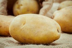 Close-up of potatoes on a sack photo