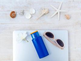 Summer vacation items with laptop photo