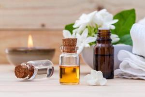 Bottle of essential oil with jasmine flowers
