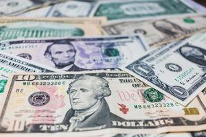American dollars or US dollar banknotes background photo