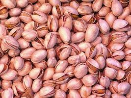 Close-up of pile of pistachios in shells