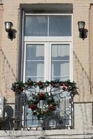 Balcony window with Christmas decorations in Vladivostok, Russia photo
