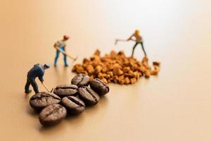 Miniature teams working together on coffee blending photo