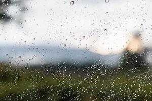 Raindrops on a window glass surface photo