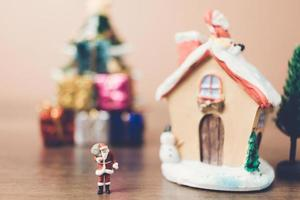 Miniature Santa Claus carrying a bag, Christmas celebration concept