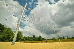 Volleyball net and sandy court in a park