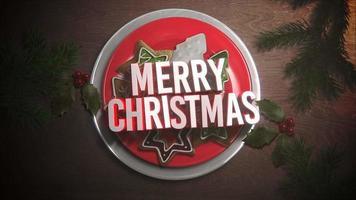 Gros plan animé texte joyeux Noël, bonbons et tarte de Noël sur fond de bois video