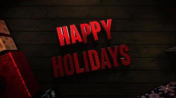 closeup animado texto de boas festas, caixas de presente e galhos de árvores verdes sobre fundo de madeira