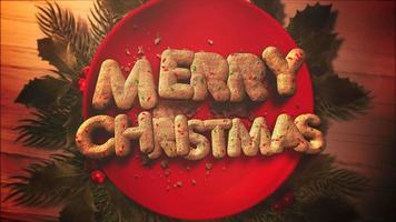Primer plano animado texto de feliz navidad, dulces y pastel de navidad sobre fondo de madera