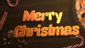 geanimeerde tekst van close-up vrolijke kerst, snoep en kersttaart op houten achtergrond video