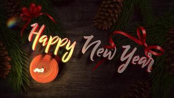 closeup animado texto de feliz ano novo, vela e galhos de árvores verdes sobre fundo de madeira