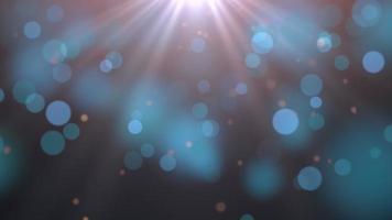 partículas abstratas voando e em movimento e bokeh redondo no fundo escuro da animação video