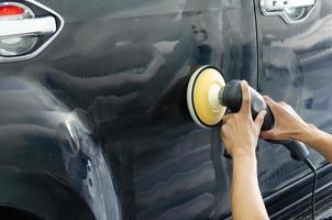 Person polishing a car photo