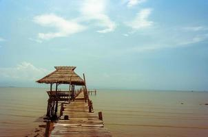 Wooden pavilion on water photo