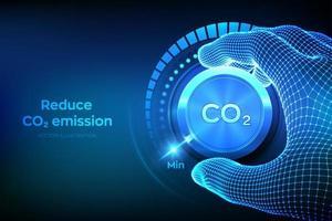 concepto de control de emisiones de dióxido de carbono. reducir el nivel de co2. Mano de estructura metálica girando un botón de perilla de dióxido de carbono a la posición mínima. concepto de reducción o eliminación de co2.