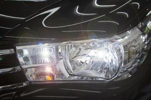 Headlight of a black car