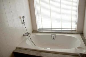 Bathtub in bathroom photo