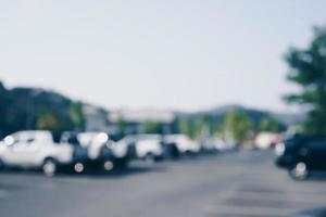 Blurred car parking lot with many cars, abstract background photo