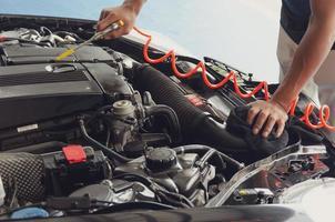 Person detailing a car engine