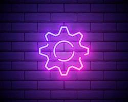 equipo, mantenimiento. icono de vector de neón rosa. símbolo de engranaje brillante aislado sobre fondo de pared de ladrillo.