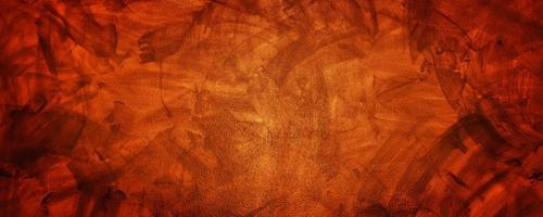 Dark yellow and orange cement or concrete wall for background or texture photo