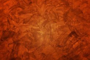 Dark orange concrete or cement wall for background or texture photo