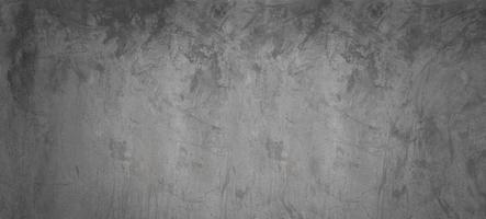 cemento gris y negro o muro de hormigón para el fondo o la textura foto