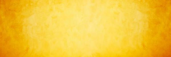 Yellow and orange cement or concrete wall for background or texture photo